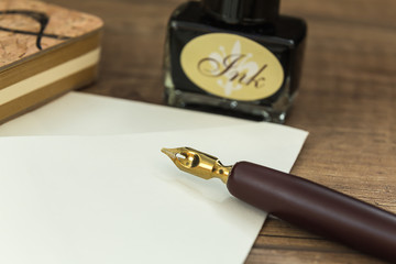 old ink pen ready to write letters