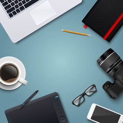 Office desk table with laptop, photo camera, glasses, graphic tablet, pencil, notebook, phone and coffee cup. Top view with copy space. Eps10 vector template.