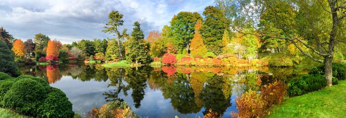 Beautiful lake and colourful trees of New England at foliage sea