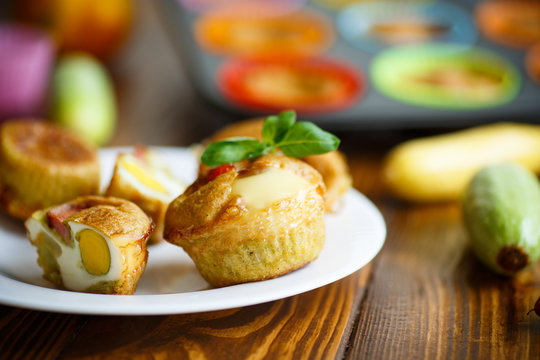 zucchini muffins baked with egg inside