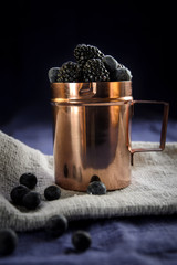 Copper cup with berries