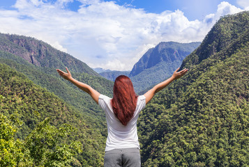 young women standing raised up arms achievements successful and celebrate success enjoy to valley view on high cliff  from top of mountain