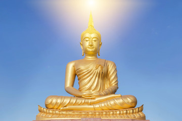 big  golden buddha statue sitting in thai temple
