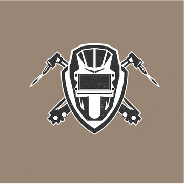 Retro vintage design logo with masks of the welder vector illust
