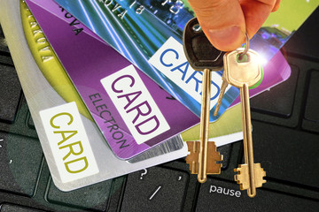 Apartment keys and credit card on computer keyboard