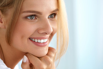 Beauty Portrait Of Woman With Beautiful Smile Fresh Face Smiling. High Resolution Image