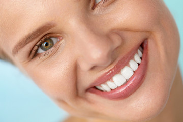 Beautiful Smile. Smiling Woman Face With White Teeth, Full Lips. High Resolution Image