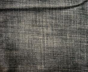 Old black jeans torn denim texture vintage