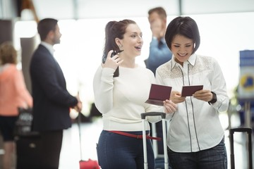 Two womens checking their passport
