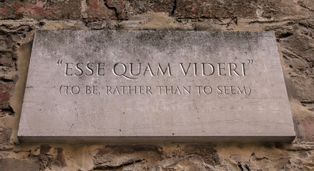 Esse quam videri. A Latin phrase meaning To be, rather than to seem (to be). Appalachian State University' s motto. Engraved text.