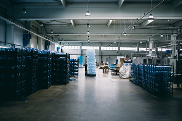 Industry interior. Warehouse of factory for purification and bottling of drinking water into bottles and canisters.