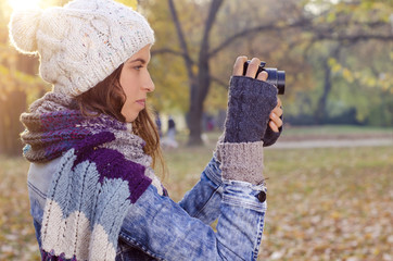 Girl taking picture in park
