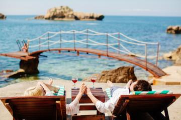 honeymoon couple relax on beach wth sea view
