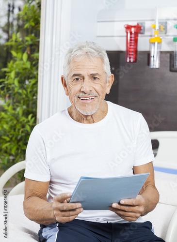 a5518dfc1ec Happy Senior Man Holding Report At Rehab Center