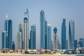Modern skyscrapers in Dubai city from Palm Jumeirah Island. UAE