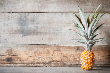 pineapple on wooden background with copyspace