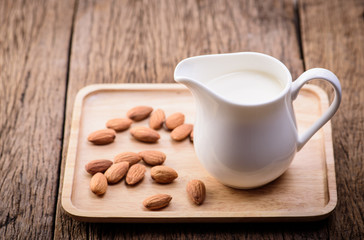 Almond milk in a jar with almonds