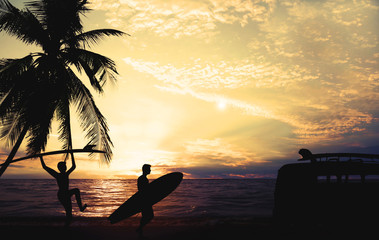 Fotomurales - Art photo styles of silhouette surfer on beach at sunset - vintage color tone