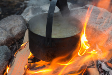 soup cooked in a pot on the fire