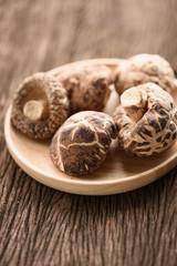 dried shiitake mushroom in wood bowl