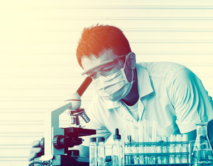 scientist with equipment and science experiments;use microscope
