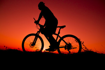 sunset and silhouette backlight bikers
