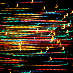 holiday illumination lights/ colorful glowing random lines on a dark background