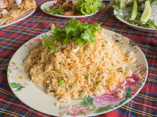 Shrimp fried rice on a white plate, On the table.