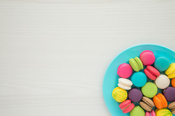 Colorful france macarons on white table background