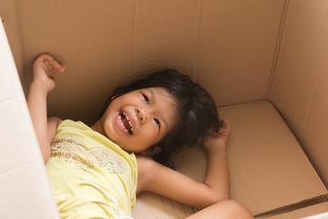 asian children smiling in a carton box