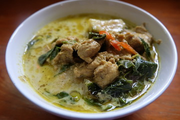 green curry chicken in coconut milk in bowl