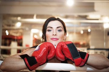 Woman portrait with boxing gloves