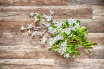 withered flowers on the wooden grunge floor, hdr image