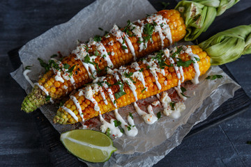 Elote or Mexican grilled corn on the cob served with cotija cheese and chili powder.