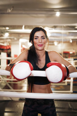 Happy woman boxer in ring