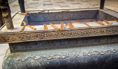 Incense burning on a copper censer - Buddhist Temple - Shanghai,