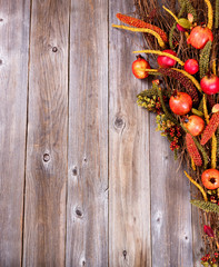 Right side border of autumn holiday decorations on wood