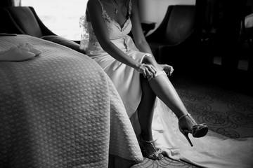 Bride Putting On Her Garter