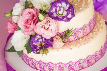 Cake is ivory color with flowers.