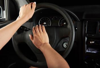 driver hands using horn