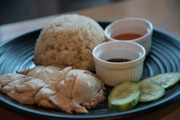 Hainan Chicken soft poached chicken with fragrant rice cucumber and chili sauce