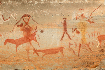 Bushmen (san) rock painting of humans and antelopes, Drakensberg mountains, South Africa.
