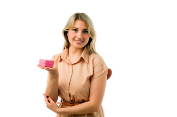 portrait of young beautiful blonde woman holding gift box isolated on white background