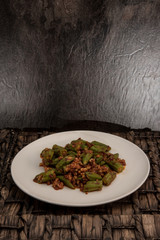 Wok fried okra with squid and sambal paste