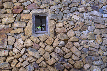 close up of a stone wall and window