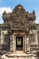 Gate in a Banteay Samre hindu temple, Angkor, Cambodia. Blue sky background