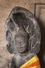 Buddha head within a a seven naga. East Mebon temple, Angkor, Cambodia