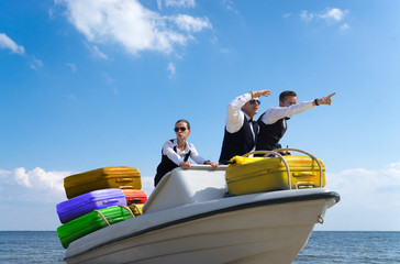 Businessmen on a boat sailing on vacation