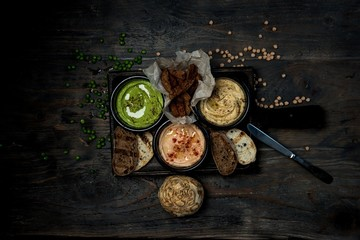 hummus in a bowl on a wooden table