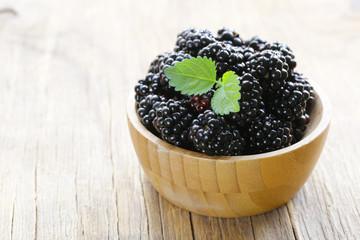 ripe juicy organic berry raspberries in a wooden bowl